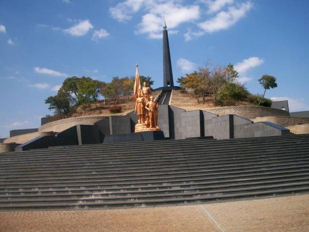 The Zimbabwean heroes acres with the Tomb of the Unknown Soldier in the foreground, the eternal fire tower in the background and elaborate stone work deco derived from the chevron pattern of the Great Zimbabwe archaeological site. (Picture by Author)