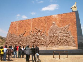 Visitors touring the Heroes Acres looking at three Bronze panels on the liberation struggle, independence and the election of R.G. Mugabe. (Picture by author